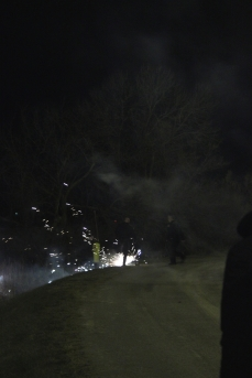 Police officers trying to stomp fire crackers
