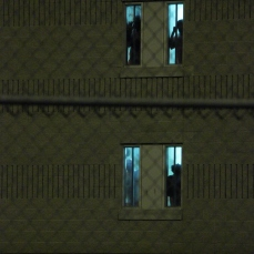 Prisoners and detainees still at their windows watching us leave.